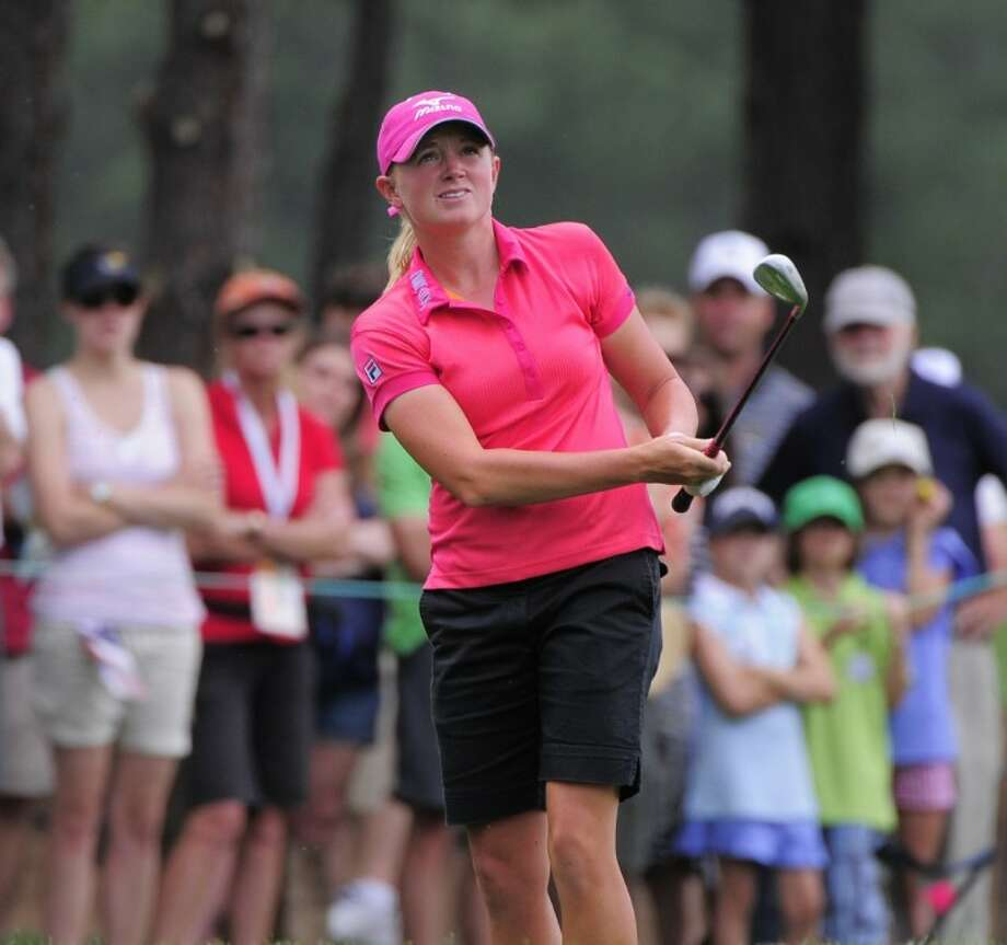 Stacy Lewis, a 2003 graduate of The Woodlands High School, watches her ball as she chips to the second hole during the second round of the Women's U.S. Open at the Broadmoor Golf Club on Friday in Colorado Springs, Colo.