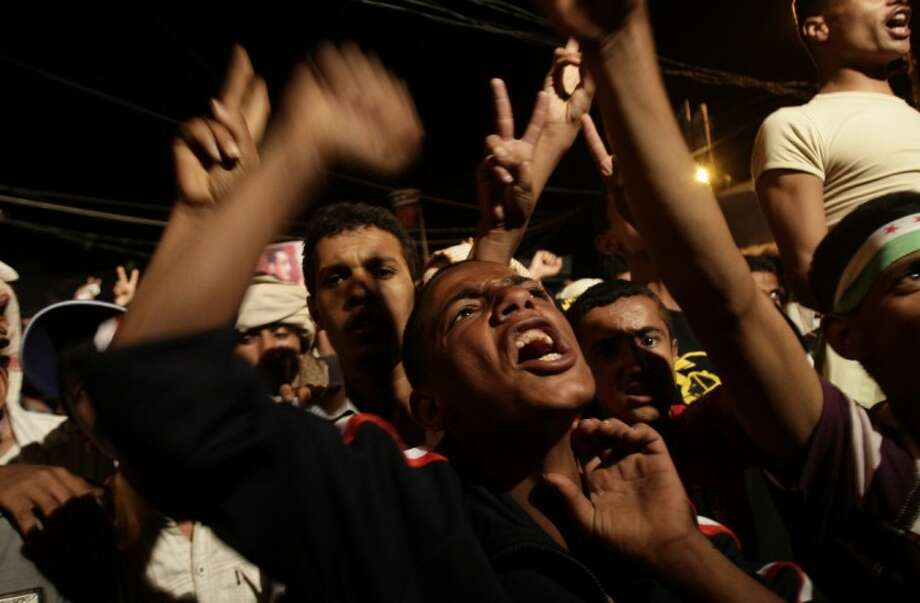 "Yemeni protestors celebrate the victory newly elected President Mohammed Morsi, during a rally at Taghyeer (Change) Square in Sanaa. Yemen, Sunday. Morsi has called for unity and said he carries ""a message of peace"" to the world. In his first televised speech on state TV, Morsi pledged Sunday to preserve Egypt's international accords, a reference to the peace deal with Israel. Photo: Hani Mohammed"