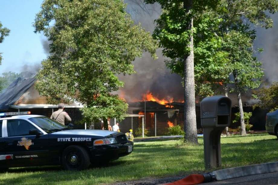 Montgomery County fire departments worked to put out a blaze that consumed a Willis home Tuesday morning. The homeowner suffered burns trying to save his pets.