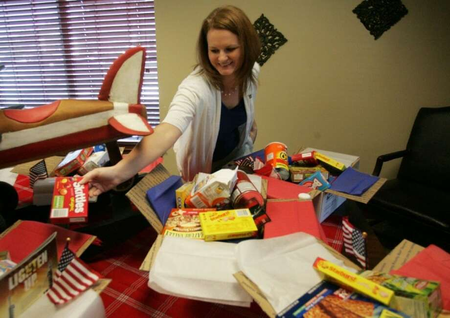 Rachel Jeffcoat helps prepare care packages Thursday during the Second Annual 4th of July Open House and Military Appreciation Benefit at FirstAmerican Title in Conroe. Photo: Eric S. Swist