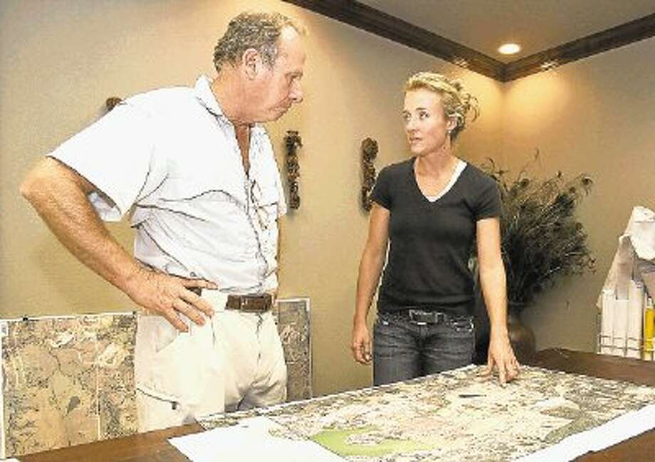 Buffalo Springs developers Philip LeFevre, left, and Hilliary Dumas review plans for Lake Creek Village, a new patio home project in Montgomery. / @WireImgId=2476107