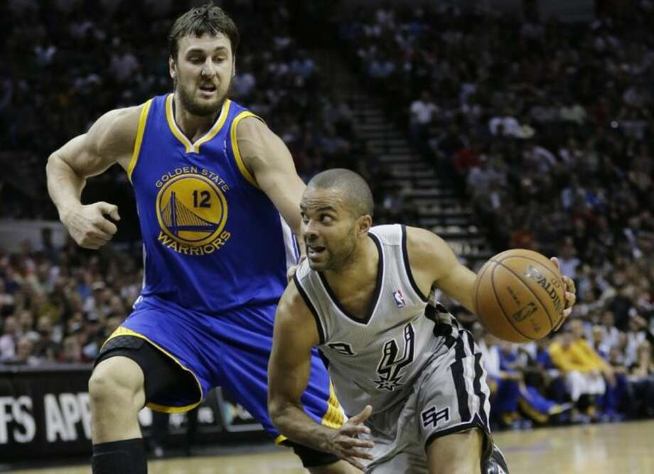 San Antonio Spurs point guard Tony Parker drives past Golden State Warriors center Andrew Bogut during the first half of Game 1 of a Western Conference semifinal series on May 6 in San Antonio. Photo: Eric Gay