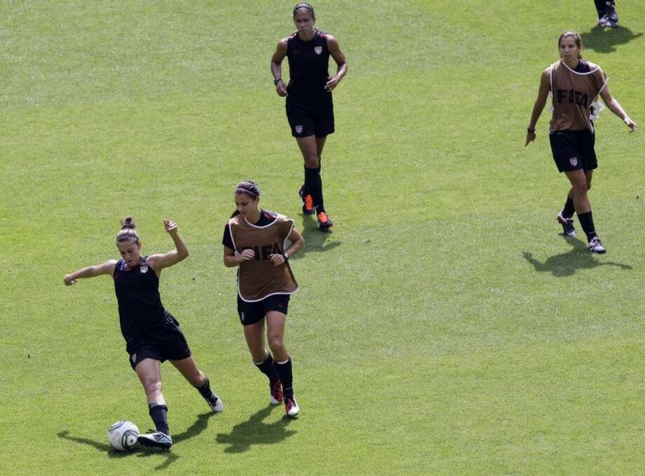 United States players, from left, Carli Lloyd, Alex Morgan, Shannon Boxx and Tobin Heath participate in a training session in preparation for a semifinal match against France during the Women's World Cup in Moenchengladbach, Germany, on Tuesday. Photo: Marcio Jose Sanchez
