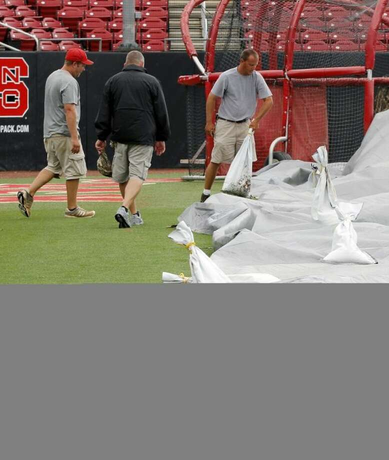 The grounds crew tends to the infield at North Carolina State's Doak Field on Friday. Rice's opening game of an NCAA super regional against N.C. State has been postponed until Saturday. Photo: Chris Seward