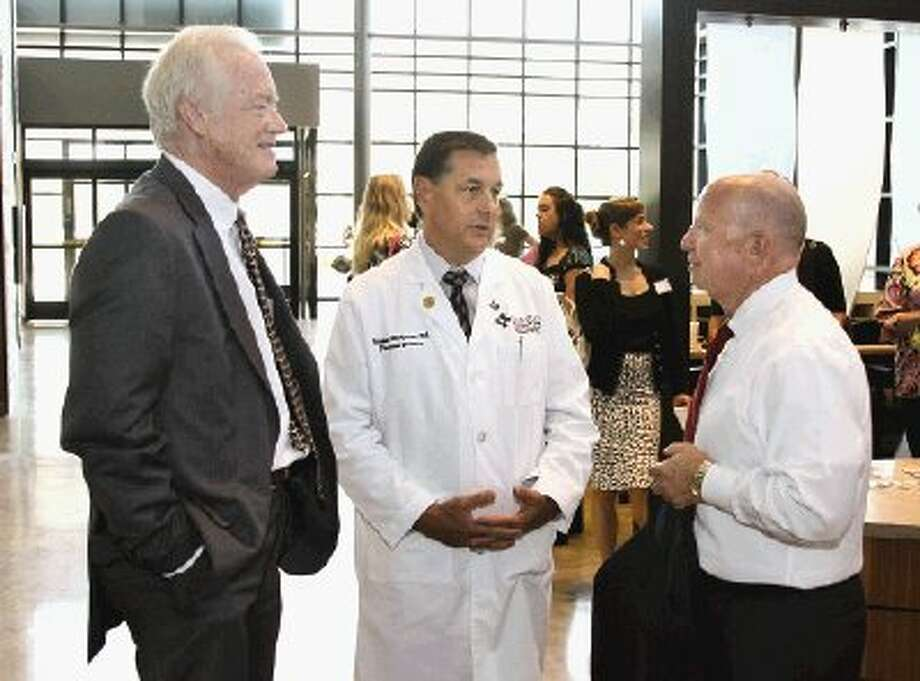 Montgomery County Judge Alan B. Sadler, left, and U.S. Rep. Kevin Brady, R-The Woodlands, right, talk with Dr. Stephen McKernan, director of the new Lone Star Family Health Center during grand-opening ceremonies Monday.