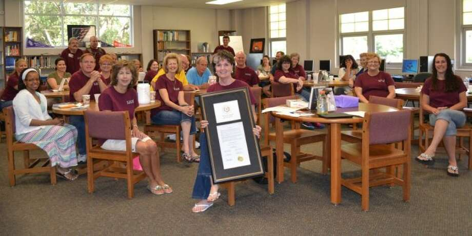 The faculty and staff of Hauke Academic Alternative School presented Principal Dr. Jo Ann Beken a proclamation from the City of Conroe, proclaiming June 7, 2013 as Jo Ann Beken Day in Montgomery County.