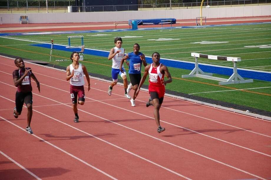 Northwest Flyers sprinter Sean Walker wins the 200 Meter Dash at USATF Region 12 Championships last week in Arlington. Walker is one of 57 Flyers athletes who qualified for the USATF Junior Olympics, July 26-31, in Wichita, Kan. Photo: SUBMITTED PHOTO