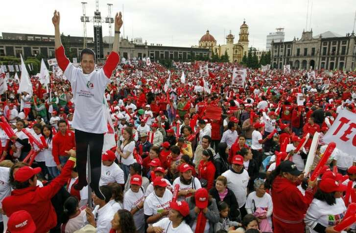 Supporters of presidential candidate Enrique Pena Nieto of the Institutional Revolutionary Party (PRI), wait for his arrival to the closing campaign rally in Toluca Mexico Wednesday.