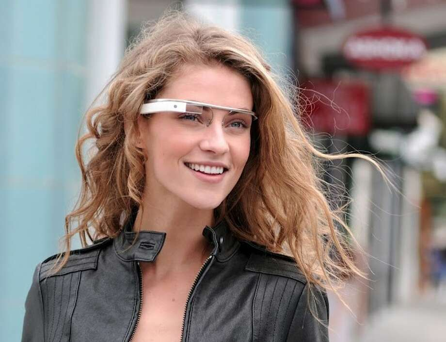 """In this undated file photo provided by the Google group's """"Project Glass"""", an early prototype of Google's futuristic Internet-connected glasses, are modeled. Google is making prototypes of its futuristic, Internet-connected glasses available for some computer programmers to try out. Photo: Anonymous / Copyright 2012 The Associated Press. All rights reserved. This material may not be published, broadcast, rewritten or redistribu"""