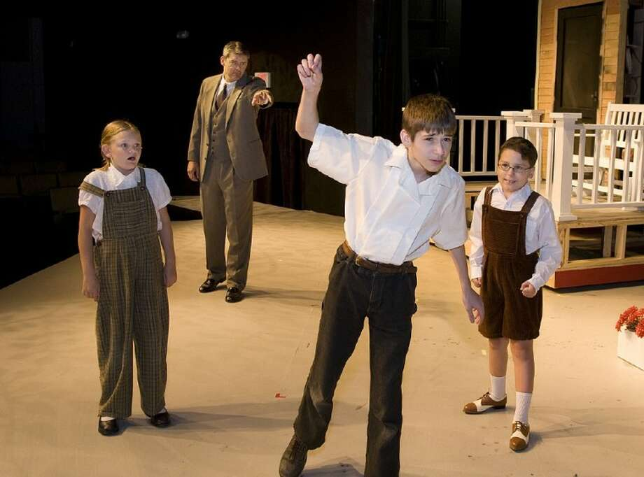 """Ken Williams, as Atticus Finch, yells a warning to the children in """"To Kill a Mockingbird,"""" portrayed, from left, by McKaylie Self as Scout, Caleb Glass as Jem and Ian Riena as Dill. The Crighton Players stage """"To Kill a Mockingbird"""" starting June 29 at the Owen Theatre in downtown Conroe."""