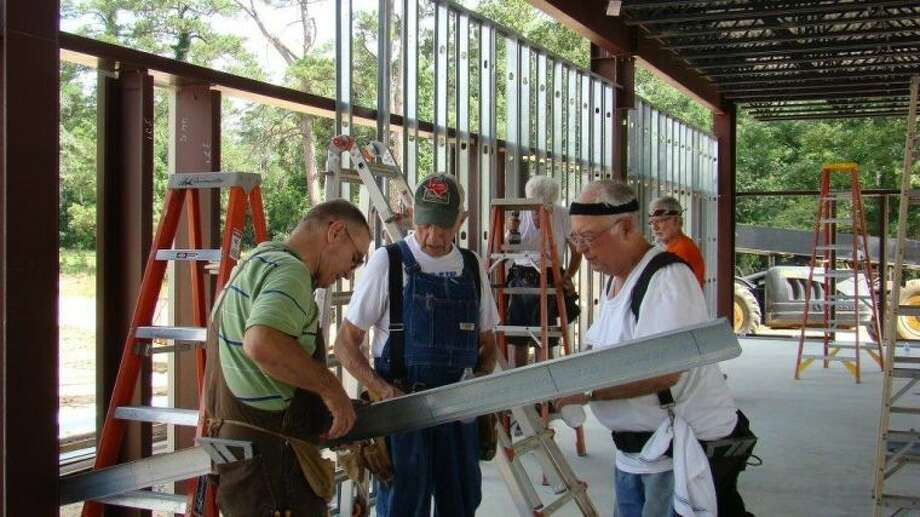 Volunteer Christian Builders Jesse Hawthorne, Wymand Swinford and John Gillespie work on the multi-purpose building for GracePoint Fellowship Church in Magnolia.