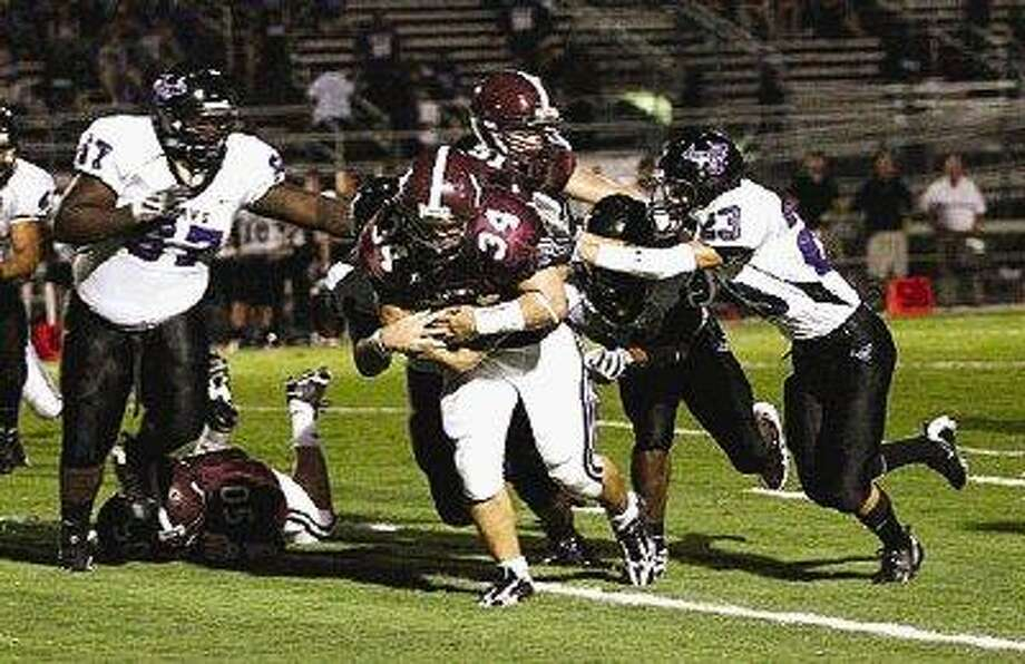 It takes four Morton Ranch Mavericks to bring down Bulldog sophomore fullback Chance David in Magnolia High School in a game last season. David, the county's newcomer of the year, will return for the Bulldogs this fall for his junior campaign. / @WireImgId=1073834