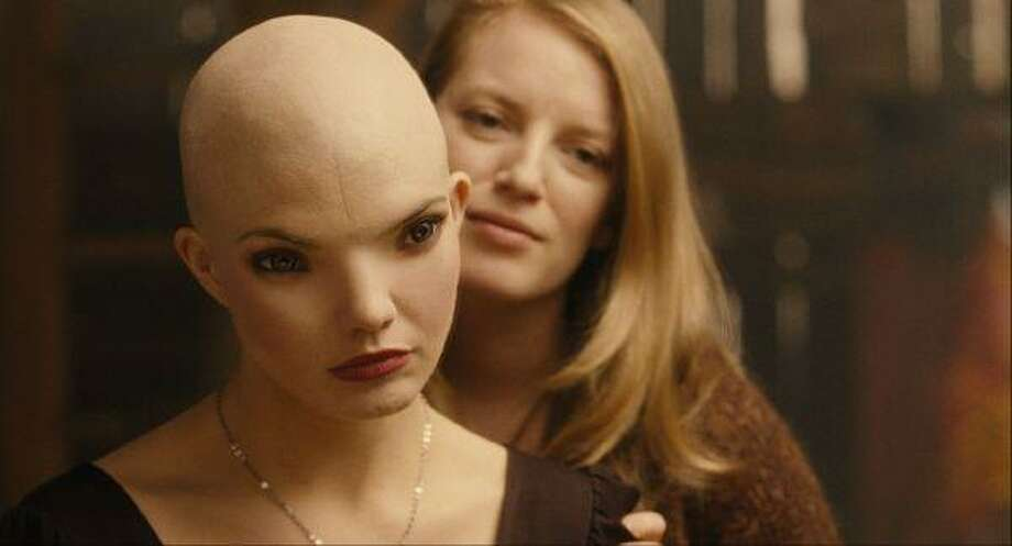 "In this film publicity image released by Warner Bros., Delphine Chaneac, left, and Sarah Polley are shown in a scene from ""Splice."" / AP2010"