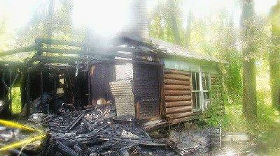 A log cabin dating back more than 100 years was destroyed by fire Monday evening.