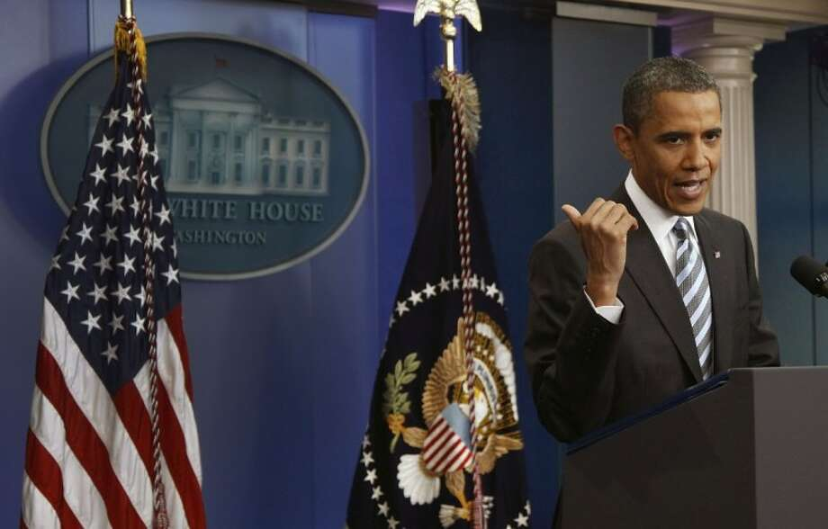 President Barack Obama answers questions on the ongoing budget negotiations during a press conference in the Brady Briefing Room of the White House in Washington on Friday. Photo: Evan Vucci