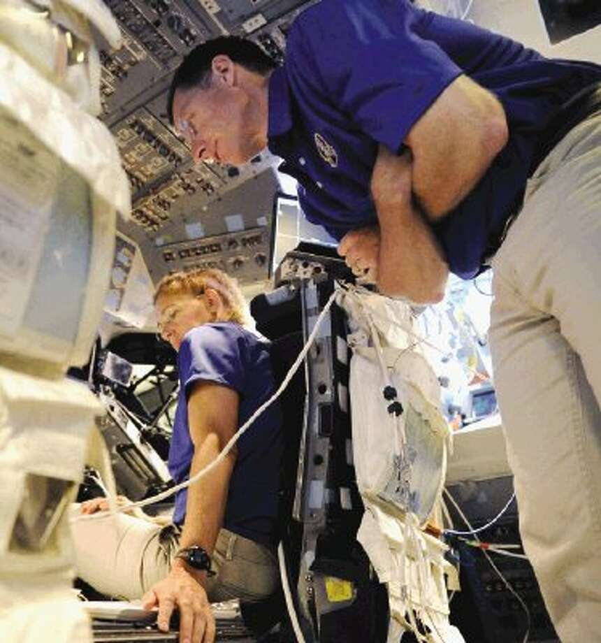 In this June 17 photo, shuttle mission specialist Sandra Magnus, left, and commander Christopher Ferguson train in a shuttle flight simulator at Johnson Space Center in Houston as they prepare for the final shuttle flight. NASA's mighty astronaut corps has become a shadow of what it once was. And it's only going to get smaller. It's down to 60 from an all-time high of 149 just a decade ago, with more departures coming once Atlantis returns this week from the very last space shuttle voyage. Photo: Pat Sullivan / AP2011