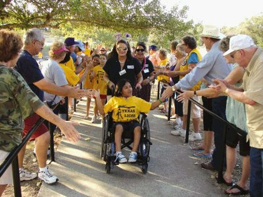 A group of Lions Club members from Conroe and around the state welcome campers July 8 to one of the awards night celebrations at the Texas Lions Camp in Kerrville.