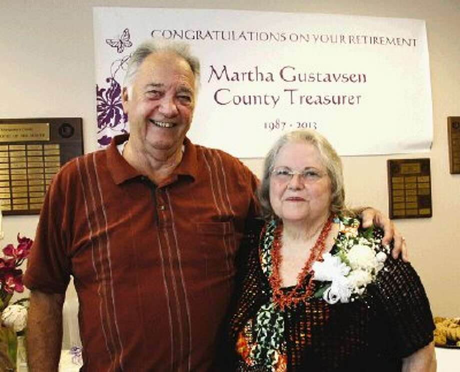 Bob Gustavsen , left, and his wife, Martha, share a moment during Martha Gustavsen's retirement party Friday as Montgomery County Treasurer. She had been with the county for more than 26 years.
