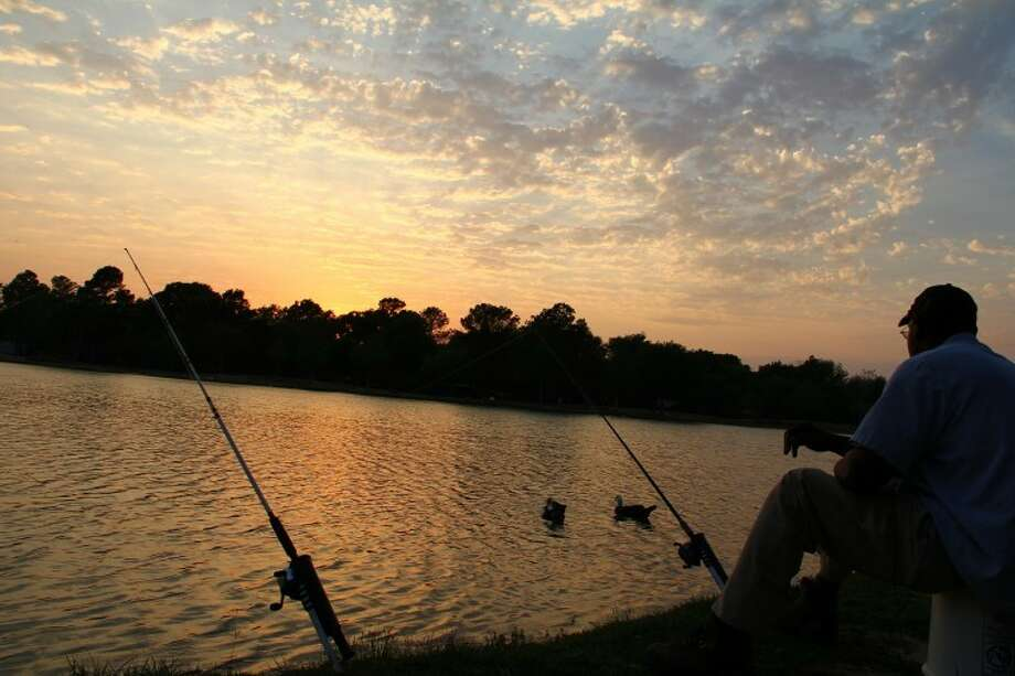 Angler Lonnie McCormick enjoyed a relaxing evening of fishing at Mary Jo Peckham Park. Photo: Photo By James Ridgway Jr.
