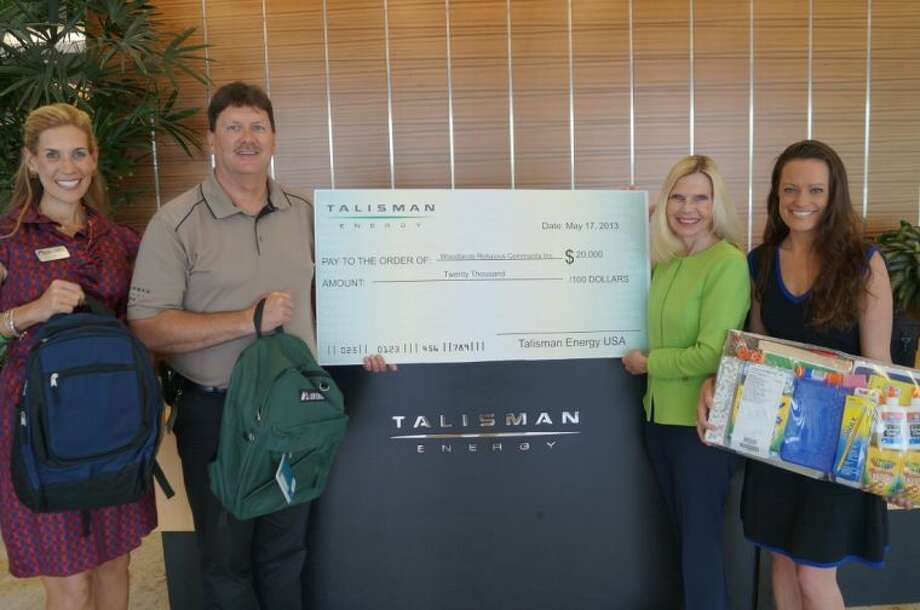 Missy Herndon, Programs and Services Director for Interfaith of The Woodlands; Scott Tompkins, Senior Advisor of Community Development for Talisman Energy; Dr. Ann Snyder, President and CEO of Interfaith of The Woodlands; and Talisman Corporate Affairs Coordinator, Sabrina Waggoner during the Talisman Energy School Supply Assistance donation on Tuesday, May 28, 2013.