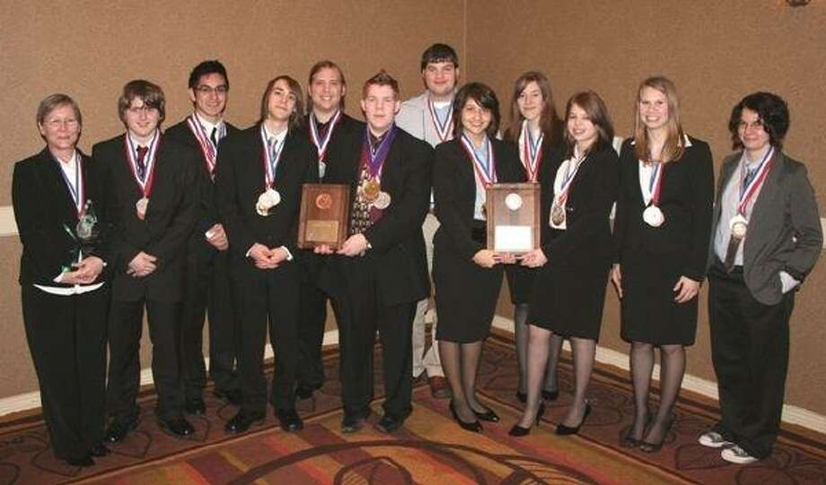 """The 2009-10 Academic Decathlon season was yet another positive one for Splendora High School and marks its sixth regional win in the past seven years. The team preserved its tradition of dominance in the regional competition by winning first overall, first in super quiz relay and first in super quiz overall. Additionally, Coach Denise Moore received the honor """"Coach of the Year."""" Pictured are head coach Denise Moore, Willie Campbell, Kris Rodriguez, Ryan Moyer, Matt Rauch, Patrick Tyler, assistant coach Travis Lawrence, Martha Casillas, Danielle Page, Ashley Hogan, Amber May and assistant coach Erica Concienne."""