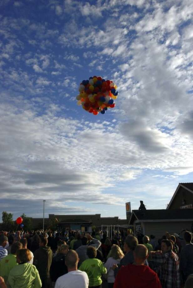 This July 5, 2008 file photo shows Kent Couch riding a lawn chair tied to more than 150 giant party balloons after taking off from his gas station in Bend, Ore. Couch now says with the high price of helium and a recent 4,500 fine from the Federal Aviation Administration, his days of flying free as a cloud in the sky may be done, at least in the U.S. Photo: Jeff Barnard