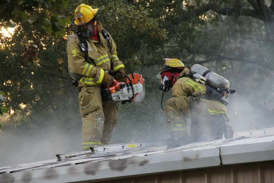 Cut and Shoot, North Montgomery and Caney Creek fire departments responded to a two-alarm residential blaze Thursday. Firefighters chopped ventilation ports on both the front and rear of the metal building.