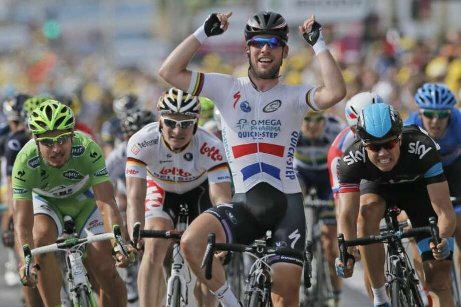 Britain's Mark Cavendish crosses the finish line ahead of Edvald Boasson Hagen of Norway, right, Peter Sagan of Slovakia, left, and Andre Greipel of Germany, second from left, to win the fifth stage of the Tour de France on Wednesday. The 142.8-mile stage started in Cagnes-sur-Mer and finished in Marseille. Photo: Laurent Rebours