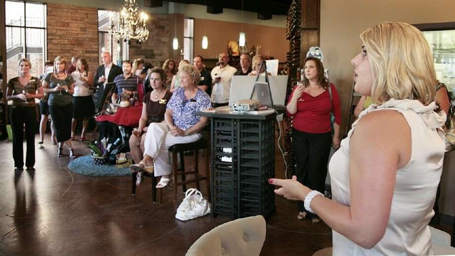 Woodforest executive Faith Bailes gives a presentation to area Realtors during a business reception hosted by the company at Cork This! in Montgomery.