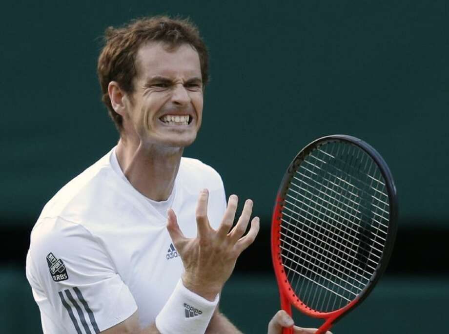Andy Murray reacts during a men's singles quarterfinal match against Fernando Verdasco at the All England Lawn Tennis Championships on Wednesday in Wimbledon, London. Photo: Jonathan Brady