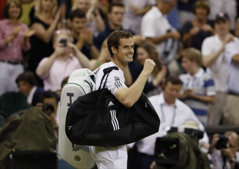Andy Murray reacts to the crowd after winning against Jerzy Janowicz of Poland during their singles semifinal. Murray, a Brit, is in the finals for the second straight year. Photo: Kirsty Wigglesworth