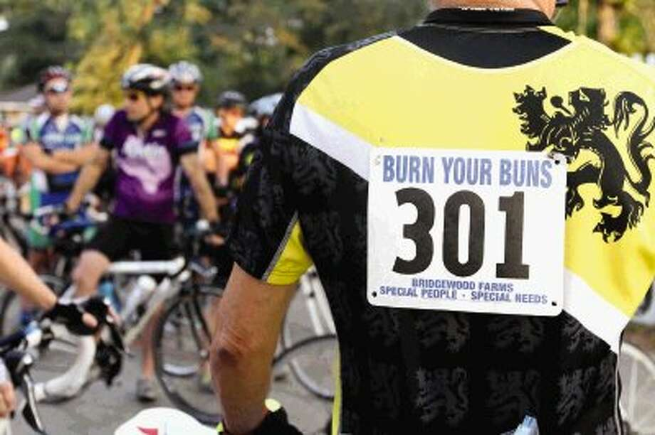 More than 300 riders participated in the annual Burn Your Buns Bike Race in Conroe on Thursday. The annual race raised funds for Bridgewood Farms, an activity center for adults with developmental disabilities. Go to HCNPics.com to view and purchase this photo, and others like it. Photo: Staff Photo By Jason Fochtman / Conroe Courier