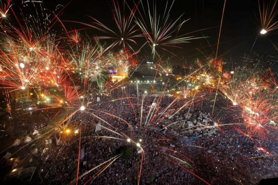 Fireworks light the sky as opponents of Egypt's Islamist President Mohammed Morsi celebrate in Tahrir Square in Cairo, Egypt, Wednesday. Photo: Amr Nabil