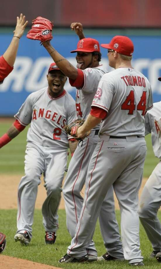 Los Angeles Angels starting pitcher Ervin Santana, center, celebrates with first baseman Mark Trumbo and shortstop Erick Aybar (2) after pitching a no-hitter in a 3-1 win over the Cleveland Indians on Wednesday in Cleveland. Photo: Mark Duncan