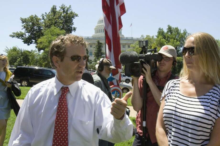 Sen. Rand Paul, R-Ky. arrives at a Tea Party rally on Capitol Hill in Washington Wednesday. Photo: Harry Hamburg