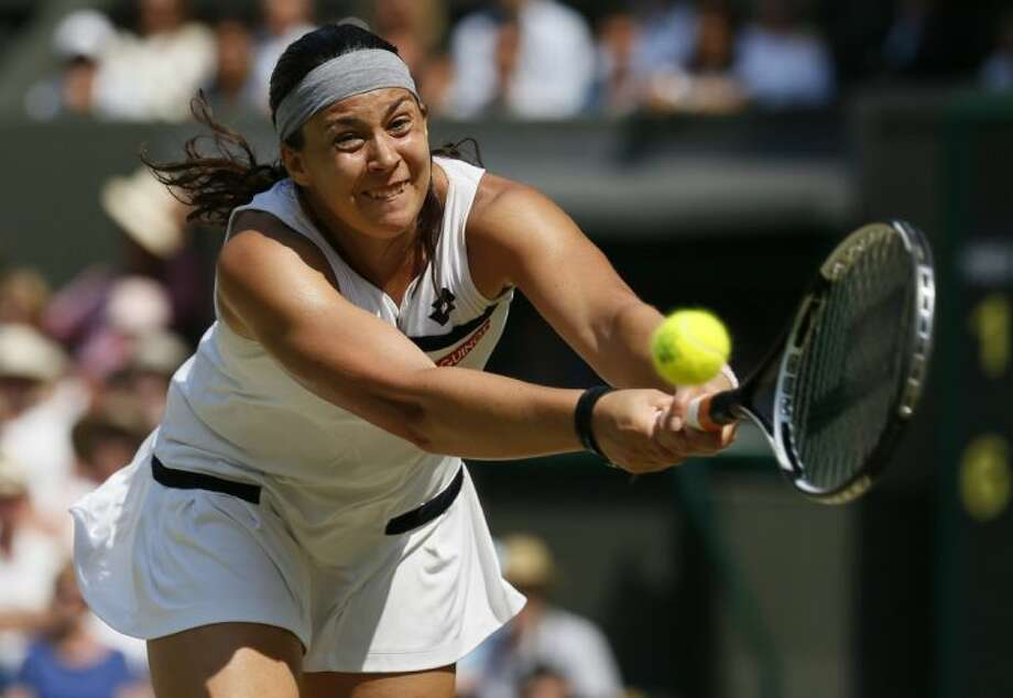 Marion Bartoli of France returns to Sabine Lisicki of Germany during their singles final at Wimbledon. Bartoli won in straight sets. Photo: Stefan Wermuth