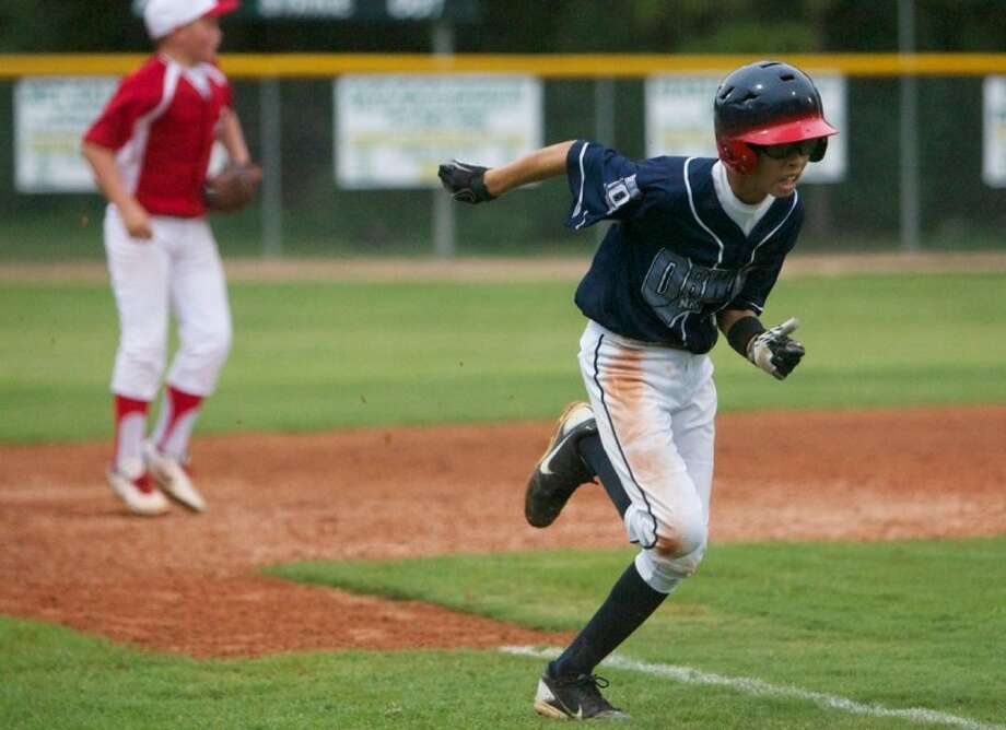 ORWALL National's Bruce Lee sprints towards home plate during Wednesday night's East Texas Seciton 2 Tournament Game against Bridge City at the ORWALL fields in Spring. Photo: Staff Photo By Eric Swist
