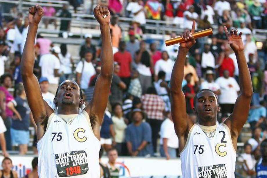 Christopher Parks and Desmon Jones celebrate after it is announced they won the 4x400-meter relay at the Class 5A State Track and Field Championships. The relay team wore No. 75 on its jersey in honor of Jordan Wilson, a Conroe football player who died in an car accident last summer. See story, Sports. / The Courier