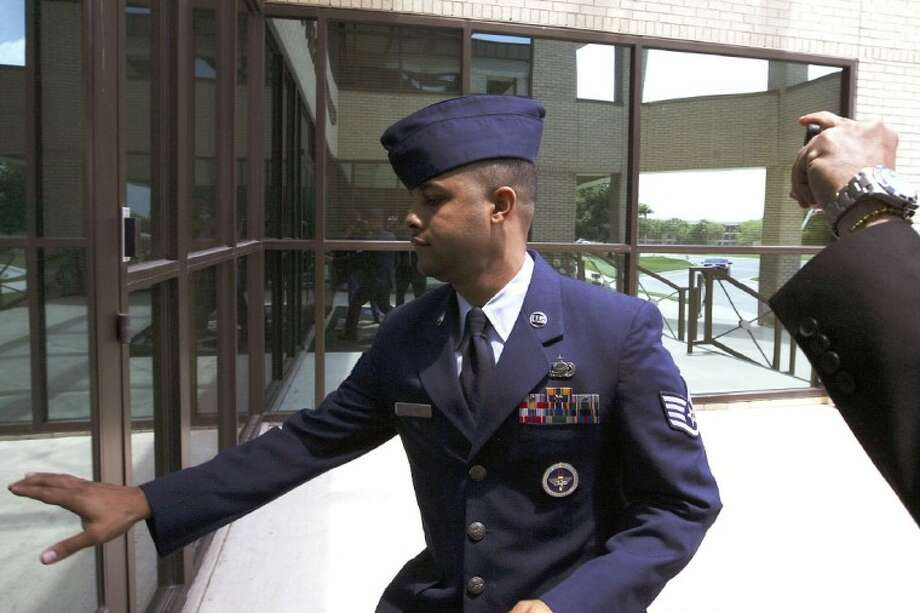 U.S. Air Force Staff Sgt. Luis A. Walker arrives from a lunch break during his court martial at Lackland Air Force Base Monday in San Antonio. Walker, a former training officer, is charged with illicit sexual contact with 10 female trainees. He is facing 28 counts including rape and is one of 12 instructors under investigation. Photo: Jerry Lara
