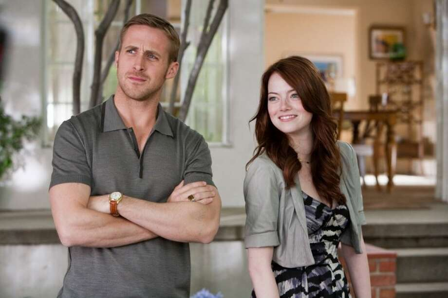 """In this film publicity image released by Warner Bros. Pictures, Ryan Gosling, left, and Emma Stone are shown in a scene from """"Crazy, Stupid, Love."""" Photo: Ben Glass"""