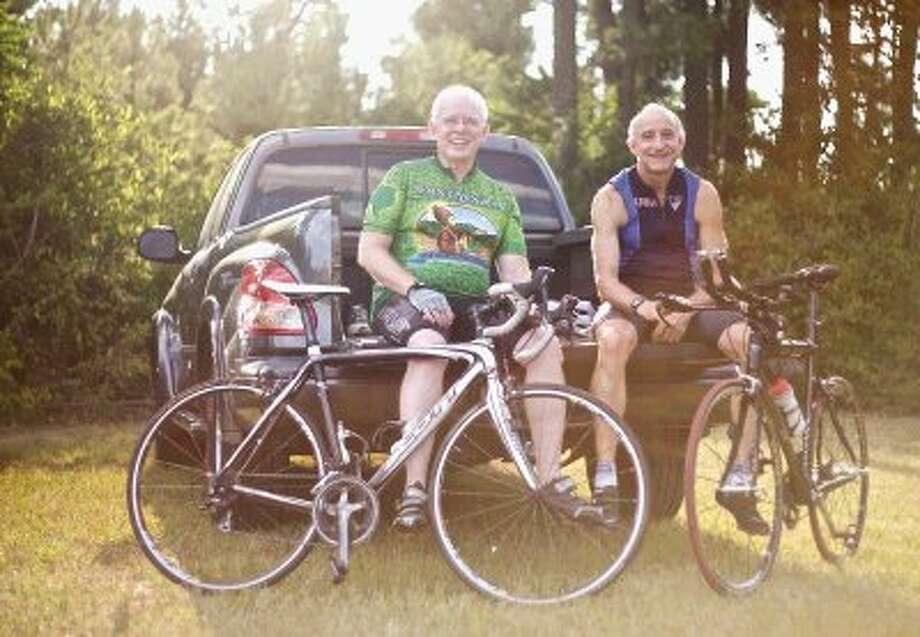 Ken Davis, 66, of Conroe, left, and Michael Dwyer, 63, will travel to the Tour de France. Photo: Staff Photo By Eric Swist