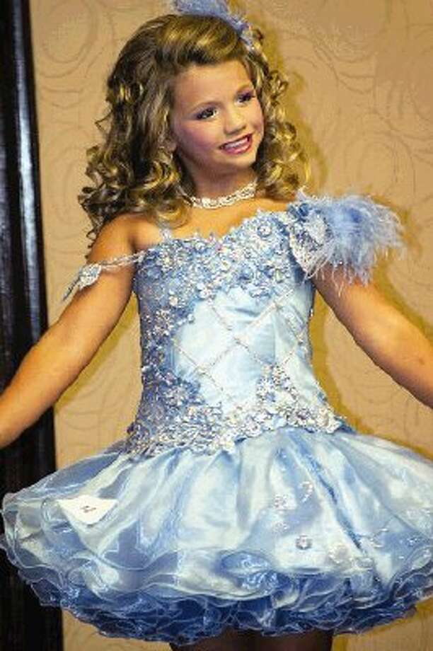 "Ava Lynn Ryan, 7, of The Woodlands, became a star on the TLC show ""Toddlers & Tiaras"" and is now considering a tour of England to promote a CD project in which she is participating."