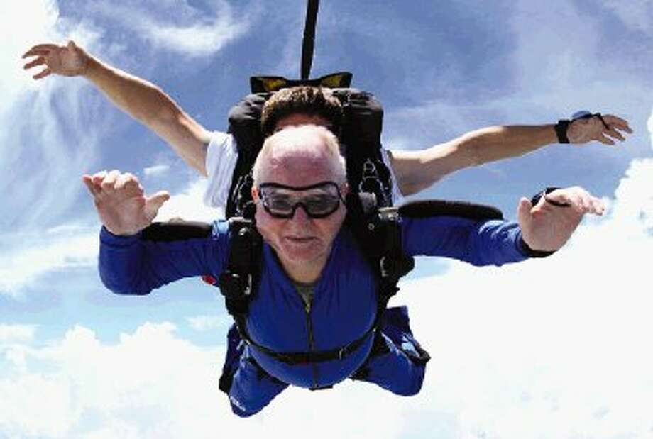 Ed Henderson, 74, of Conroe can cross one more thing off his bucket list as he completed a tandem skydiving jump Thursday at Skydive Spaceland in Rosharon, Brazoria County. The Rivershire resident hopes to be able to do a solo dive on his 75th birthday in March.