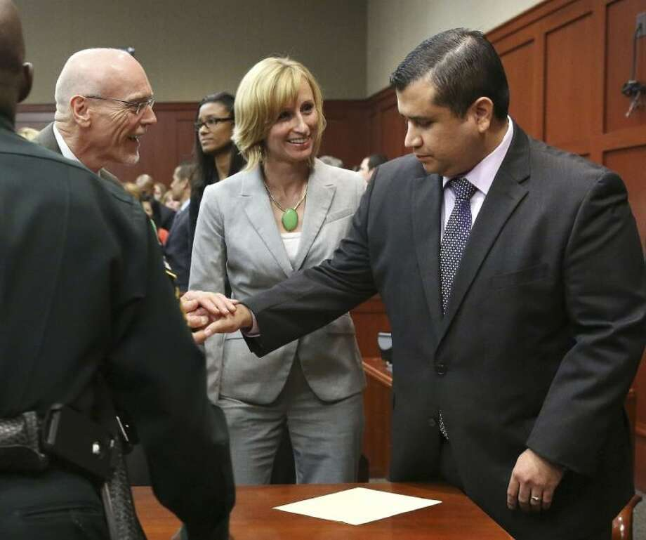 George Zimmerman, right, is congratulated by his defense team after being found not guilty during Zimmerman's trial in Seminole circuit court in Sanford, Fla. on Saturday. Photo: Gary W. Green