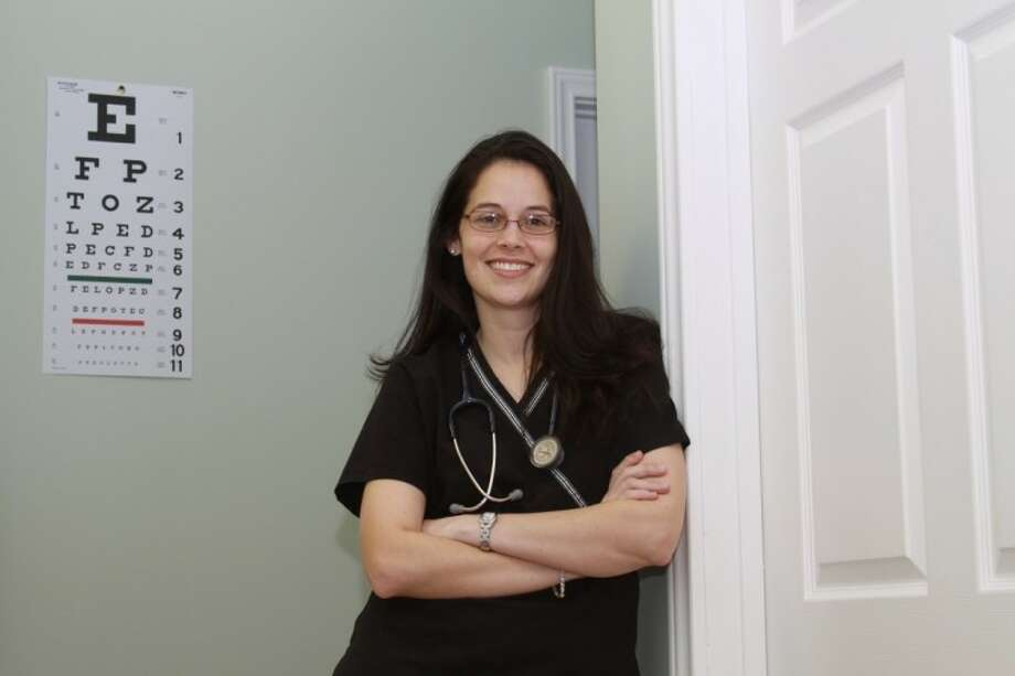 Melissa Herpel stands in the hallway of her newly expanded Express Family Clinic on Rayford Road.