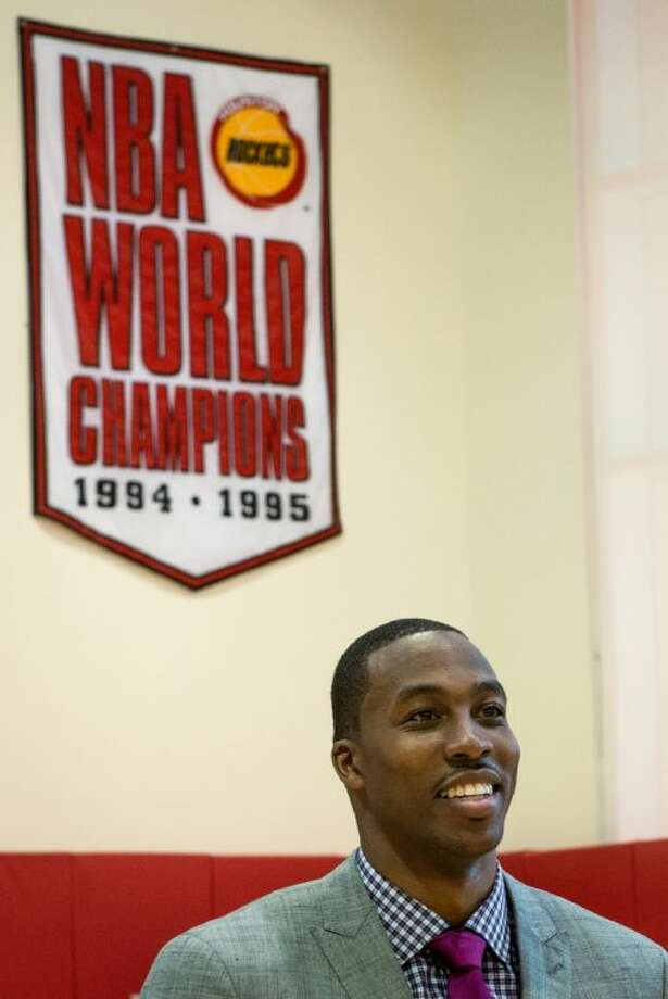 Dwight Howard smiles as he waits for a photo shoot after he was introduced as the newest member of the Houston Rockets during a ceremony at the Toyota Center on Saturday in Houston. Photo: Smiley N. Pool