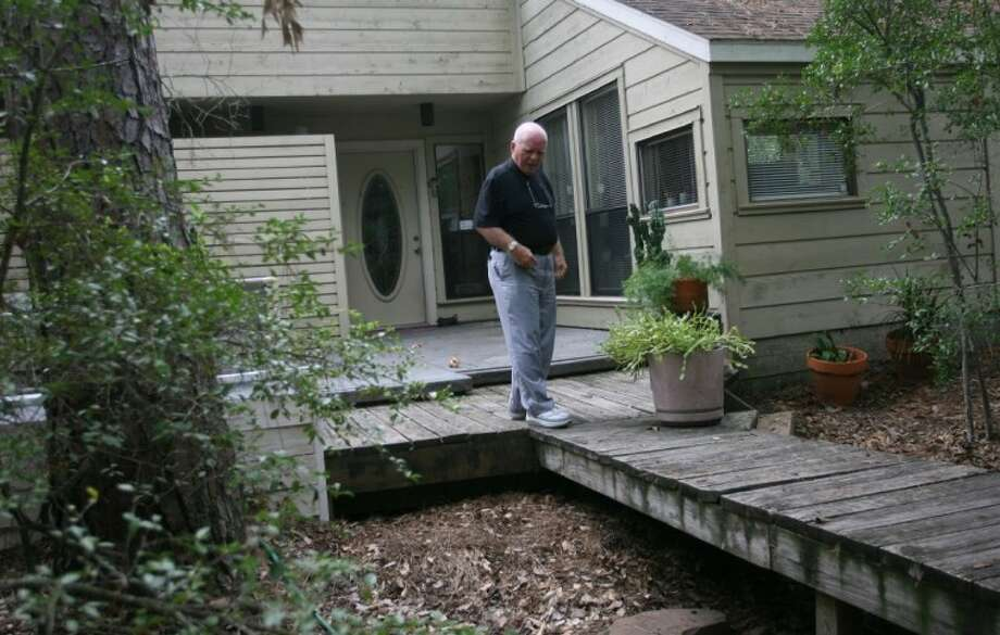 "Joe Fleishner talks about the natural, low-maintenance approach he has taken with his front yard at his home in The Woodlands. Fleishner's landscaping is an example of xeriscaping. A natural irrigation path, which he calls the ""river walk"" runs beneath a small walk-bridge and deck at the front of the home."