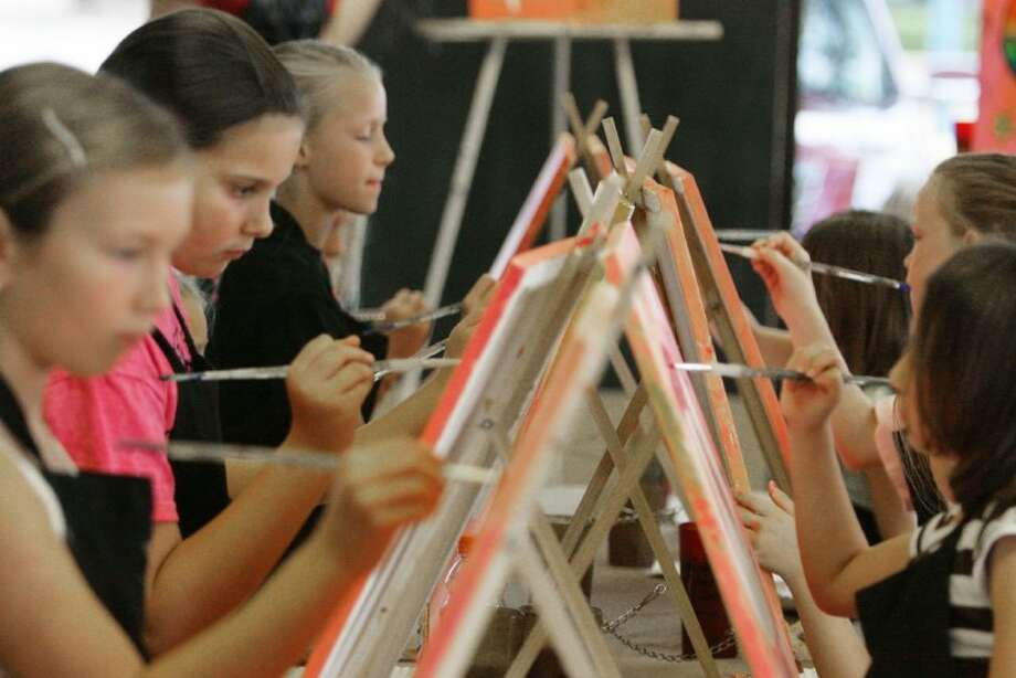 Students take part in Painting with a Twist's Summer Art Camp in Conroe.