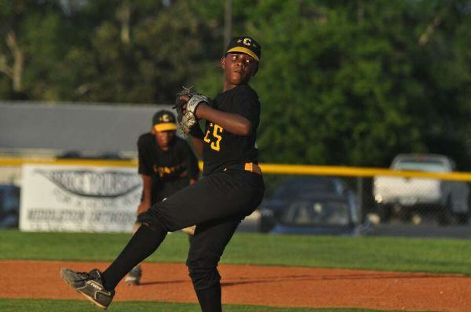 Conroe All Star pitcher D.D. Johnson winds up during the District 28 AAA Minor Championship game in Montgomery Monday night.