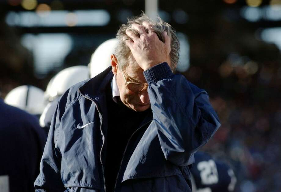 In this Nov. 6, 2004, file photo, Penn State coach Joe Paterno pauses on the sidelines during the fourth quarter of his team's 14-7 loss to Northwestern in State College, Pa. The NCAA has slammed Penn State with an unprecedented series of penalties, including a 60 million fine and the loss of all coach Joe Paterno's victories from 1998-2011, in the wake of the Jerry Sandusky abuse scandal. Photo: Carolyn Kaster